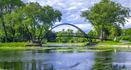 Tenney park metal arch bridge